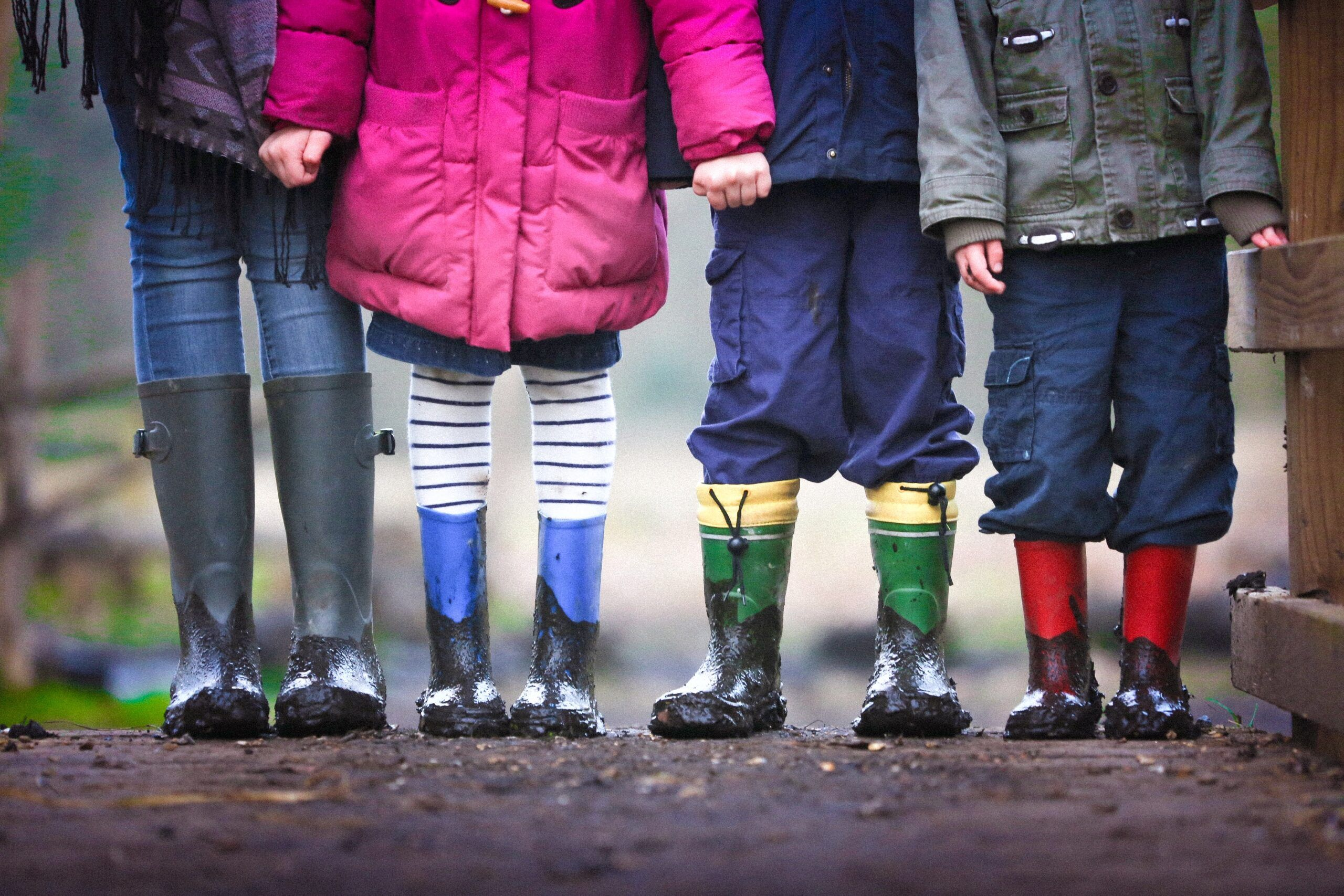 Four Children standing on a muddy path together